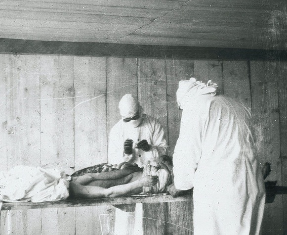 American doctors Strong and Teague perform an autopsy on a plague victim